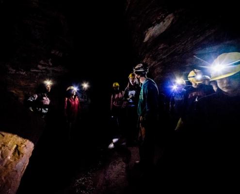 Participants climbing through Laurel Caverns